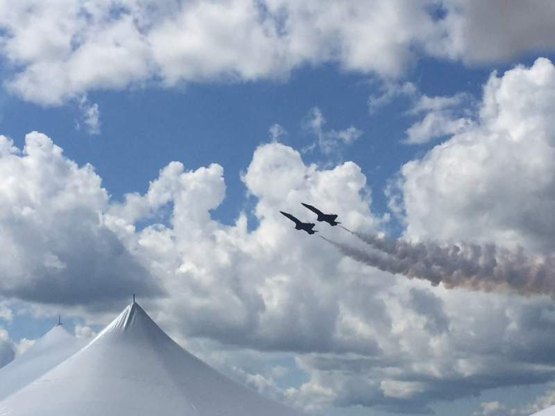 Two-jets-side-by-side-above-an-event-tent